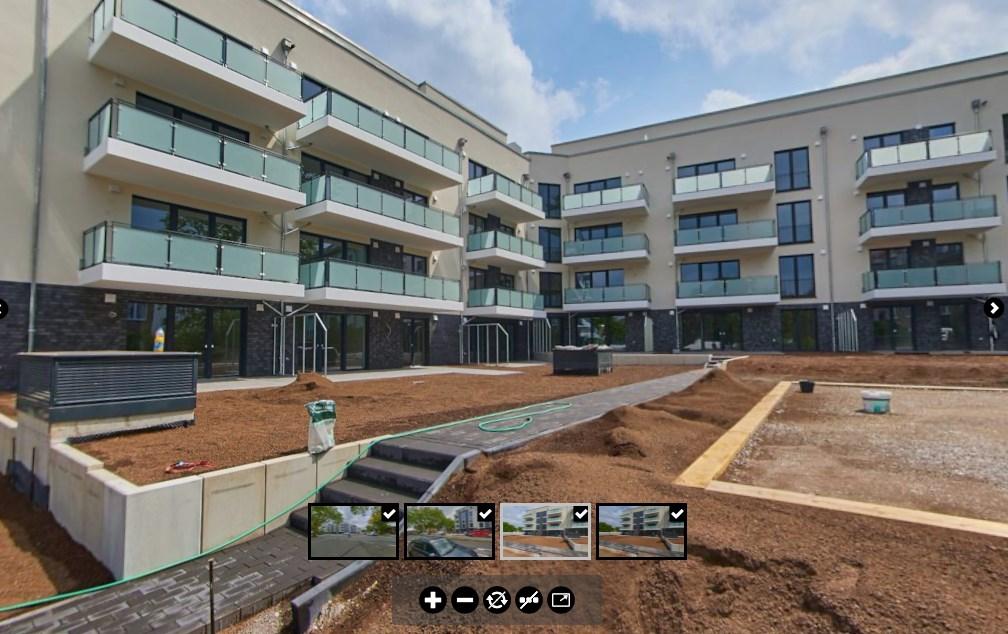 Ansicht des Innenhofs, ein paar Wochen vor der Fertigstellung, Boulebahn und Balkone sind sichtbar